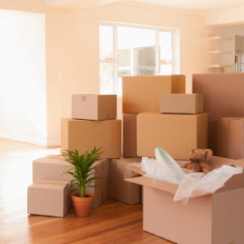Moving boxes on floor. Bristol Global Mobility offers move management services.